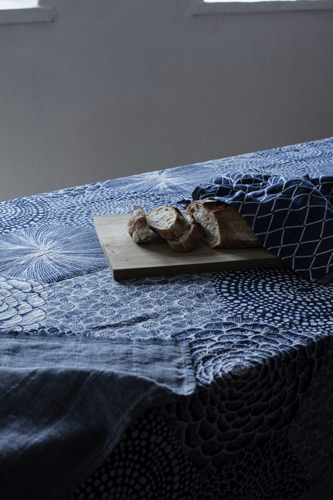 Katinka Kreative a blue table cloth and bread